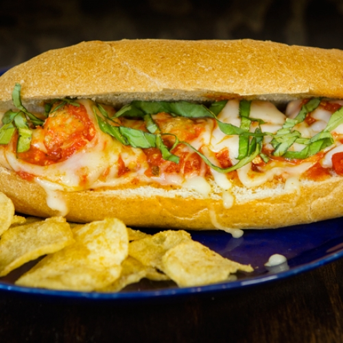 Turkey Meatball Sub served with potato chips